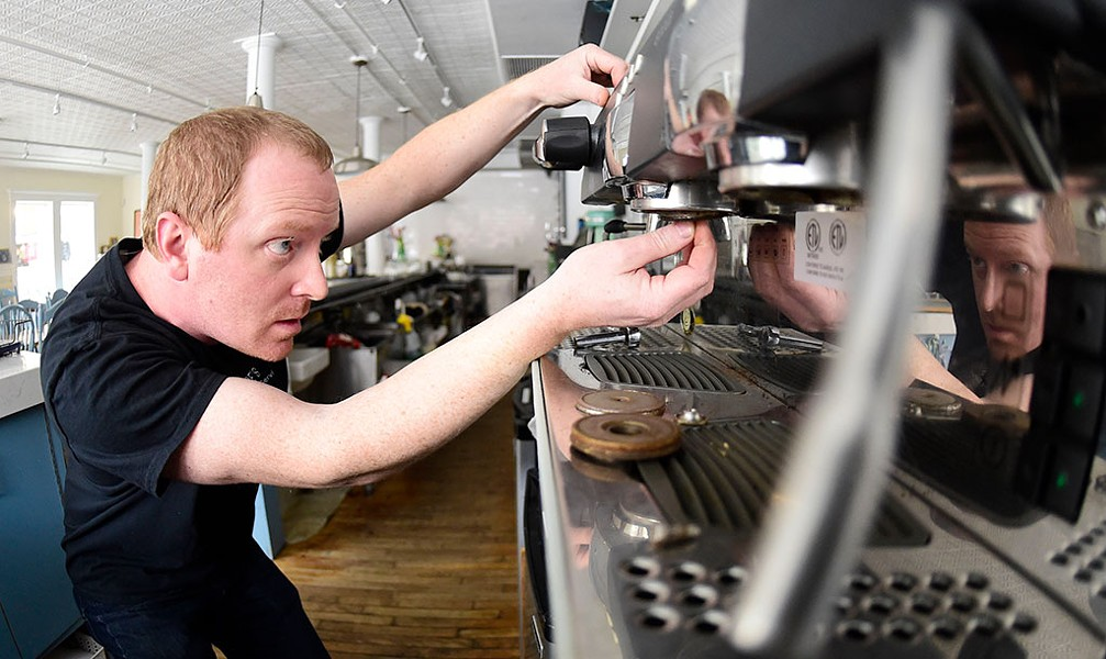Ben Colley working on an Italian espresso machine at Down Home Kitchen in Montpelier - JEB WALLACE-BRODEUR