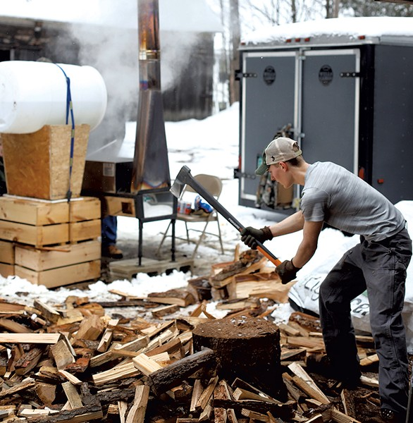 Student chopping wood - SARAH PREISTAP