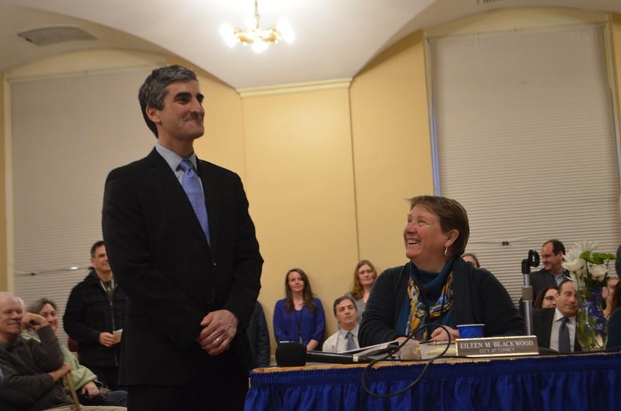 Mayor Miro Weinberger, as city attorney Eileen Blackwood looks on. - KATIE JICKLING