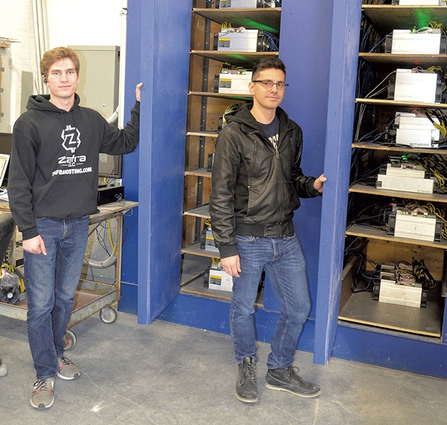 Ryan Brienza (left) and David Bowman with Bitcoin mining machines - MOLLY WALSH