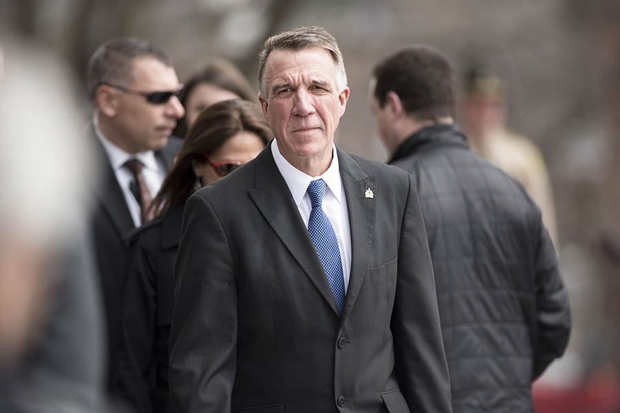 Gov. Phil Scott arrives at the statehouse for the bill-signing ceremony. - JOSH KUCKENS