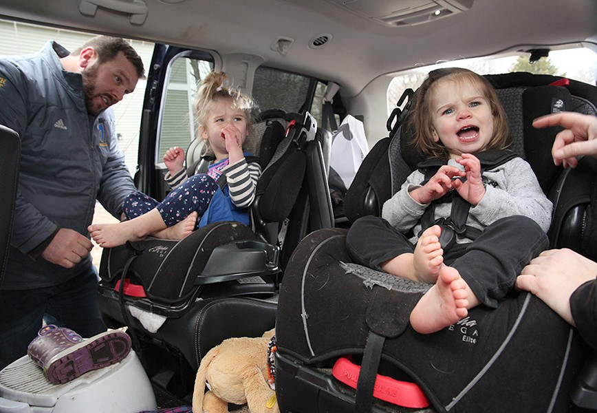 Jake, Bree and Genevieve Scott piling into the car - MATTHEW THORSEN