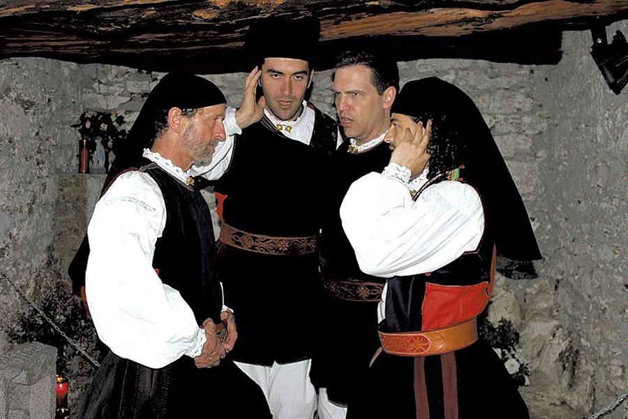 Tenores de Aterúe singing in a cave in Sardinia - COURTESY OF DOUGLAS PAISLEY