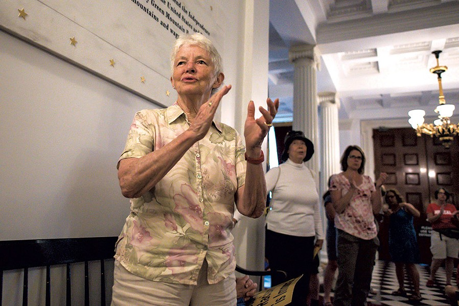Robin Lloyd joining in a song during a Vermont Poor People's Campaign rally at the Vermont Statehouse - GLENN RUSSELL