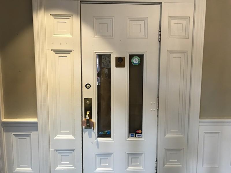 The locked restaurant door - SALLY POLLAK