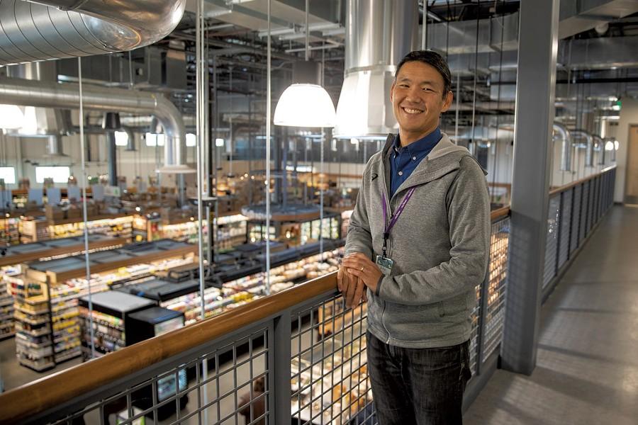 John Tashiro, general manager, at City Market South End - JAMES BUCK
