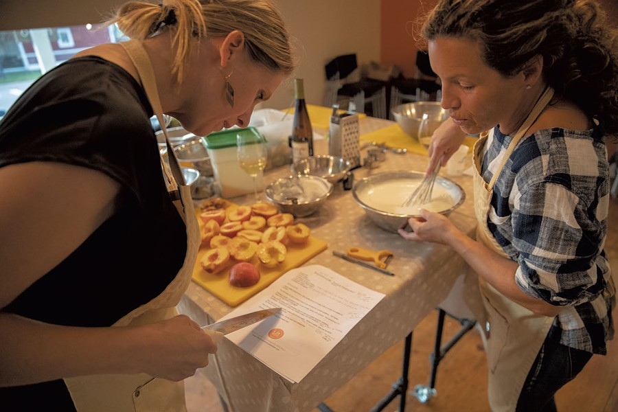 Students preparing peaches for dessert at a Richmond Community Kitchen class - JAMES BUCK