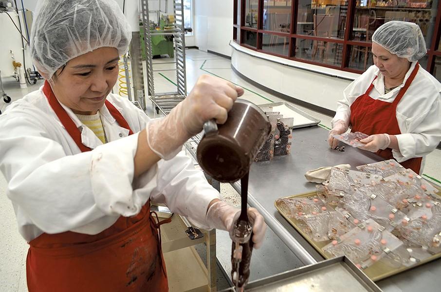 Vietnam natives Hoa Thi Nguyen (left) and Elena Le at Lake Champlain Chocolates - KEVIN MCCALLUM