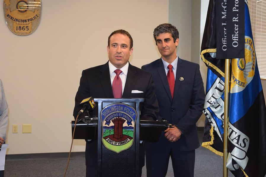 Brandon del Pozo (left), newly appointed as Burlington's  next police chief, speaks Tuesday after being introduced at a press conference by Mayor Miro Weinberger (right). - TERRI HALLENBECK