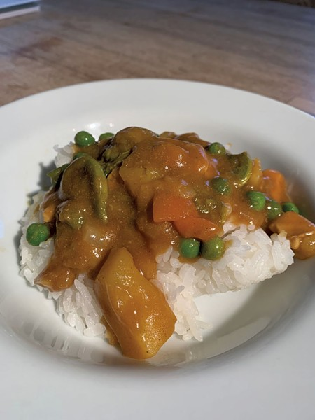 Vermont Curry prepared with added peas, - carrots, fiddleheads and organic chicken - DAN BOLLES