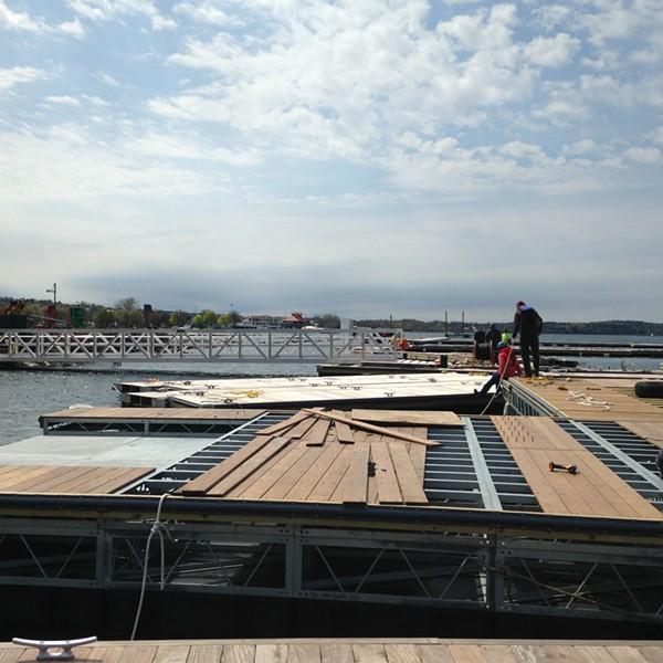 Workers assemble docks and slips at the Burlington Harbor Marina. - MOLLY WALSH