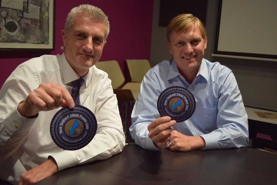 TDI New England president and chief executive officer Donald Jessome (left) and Project Manager Josh Bagnato hold disks that represent the circumference of two transmission lines the company proposes to place under Lake Champlain. - TERRI HALLENBECK