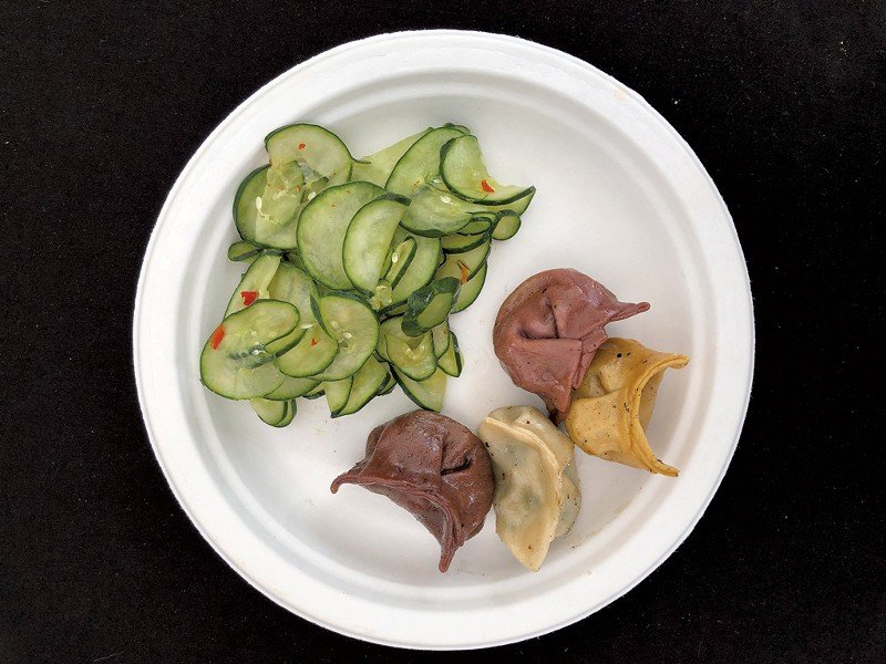 Marinated cucumber and potsickers from Green Mountain Potstickers - DAVID HOLUB