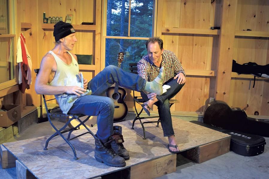 Rusty DeWees shows Ric Cabot his Darn Tough sock - TERRI HALLENBECK