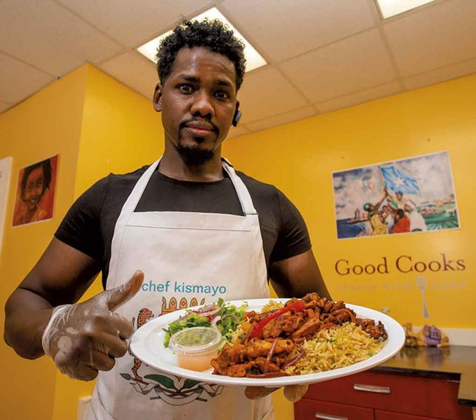 Chef Ahmed Omar with a classic Somali dish of rice and chicken - GLENN RUSSELL