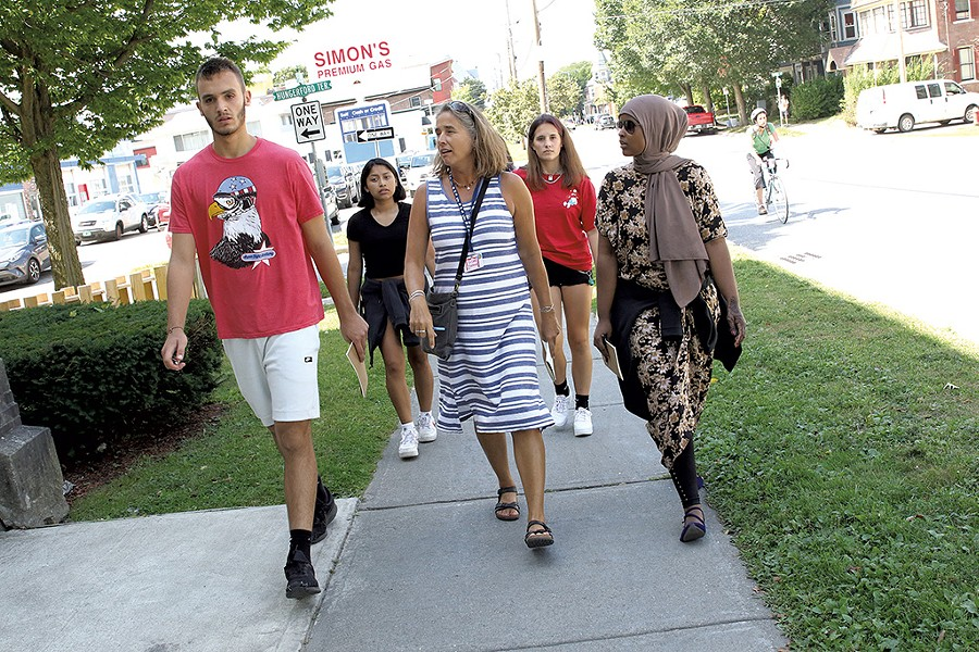 BCL students walk up Pearl Street with teacher Signe Daly - COURTNEY LAMDIN