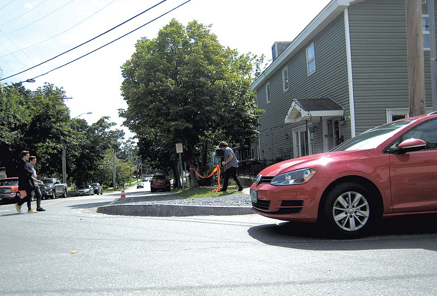 The curb at St. Paul and Maple streets - DIANE SULLIVAN