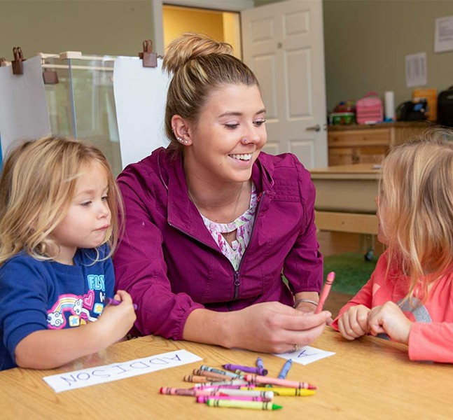 Brianna Hawksworth spending a few minutes with her daughters, Addison and Aubree, before leaving for work - WAYNE TARR