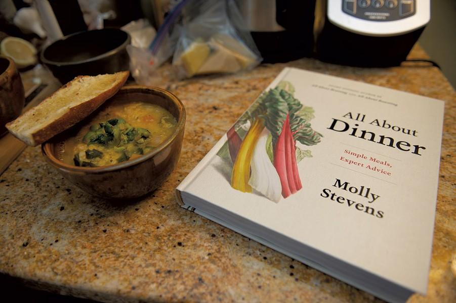 Vegetable-and-lentil soup alongside Molly Stevens' cookbook All About Dinner - DARIA BISHOP