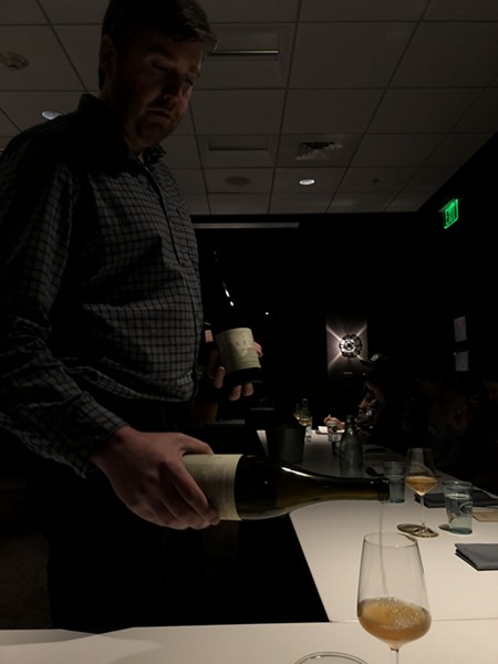 Matt Canning pouring wine for workshop participants - JORDAN BARRY