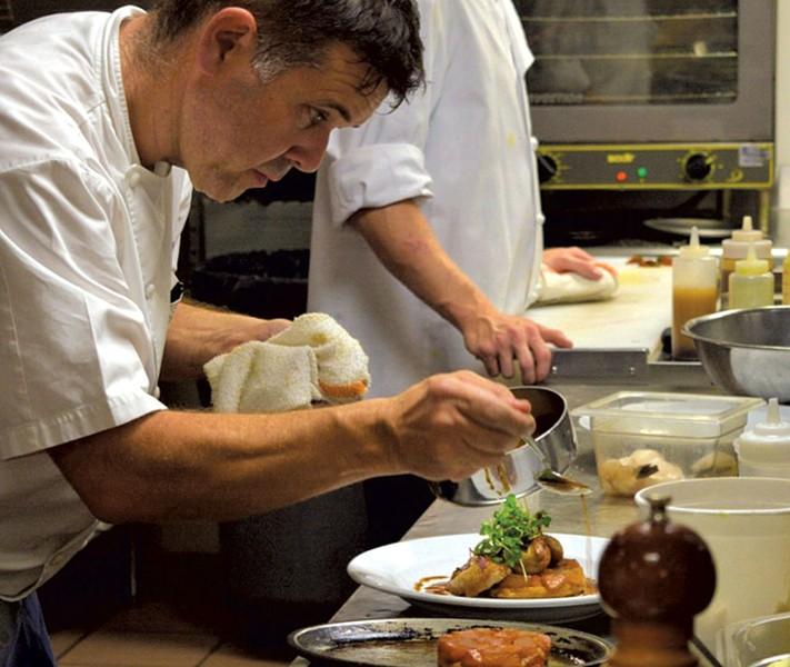 Herve Mahe plating food at Bistro de Margot - COURTESY OF HERVE MAHE