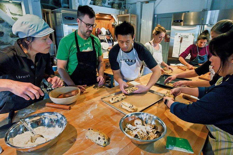 Heike Meyer (left) helping students prepare loaves of stollen - GLENN RUSSELL