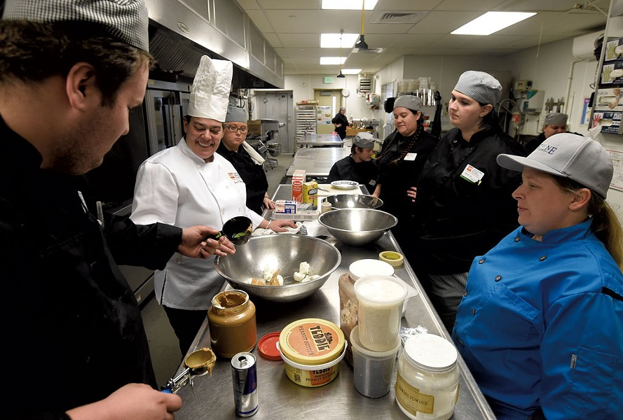 Chef Joey Buttendorf teaching at the Community Kitchen Academy - JEB WALLACE-BRODEUR