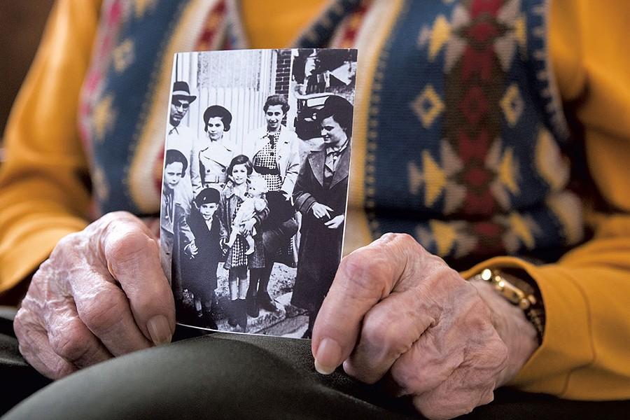 Jane Keibel holding a photo taken in France, 1939, when she was 15 - COLIN FLANDERS