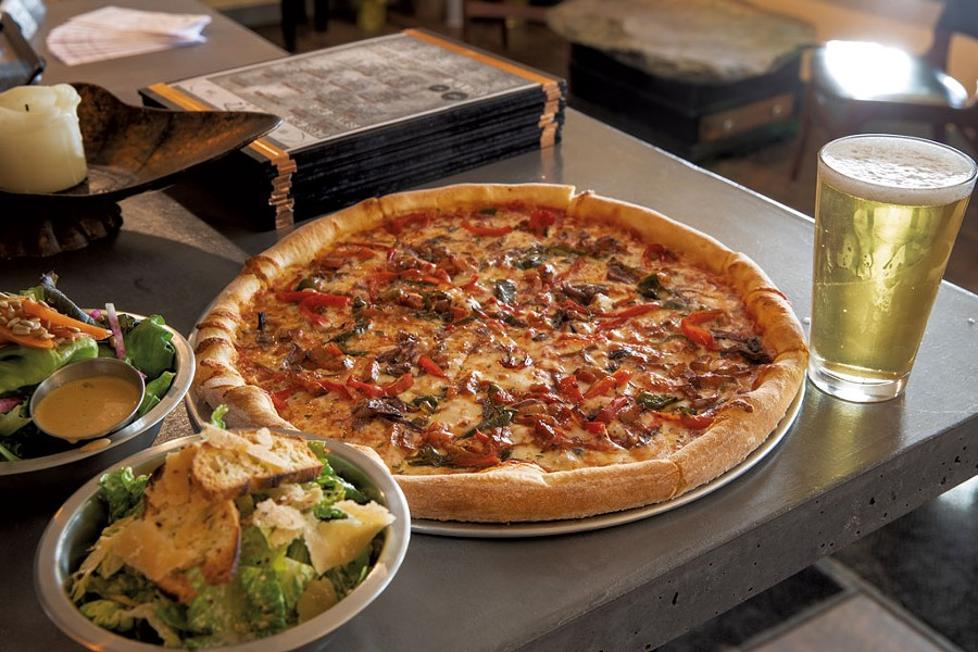 Pizza and salad at Stone's Throw in Fairfax - JAMES BUCK/FILE