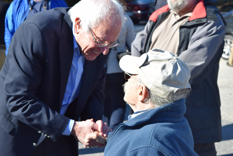 Sen. Bernie Sanders (I-Vt.) greets a New Hampshire union member after a press conference in Concord on Saturday. - TERRI HALLENBECK