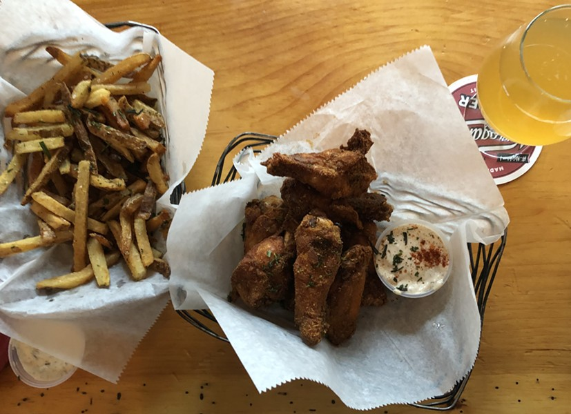 Dry-rubbed chicken wings and fries at St. Paul Street Gastrogrub - JORDAN BARRY