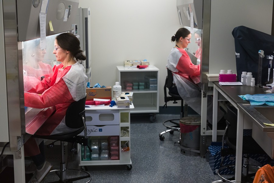 Workers at the Vermont Health Department lab - OLIVER PARINI
