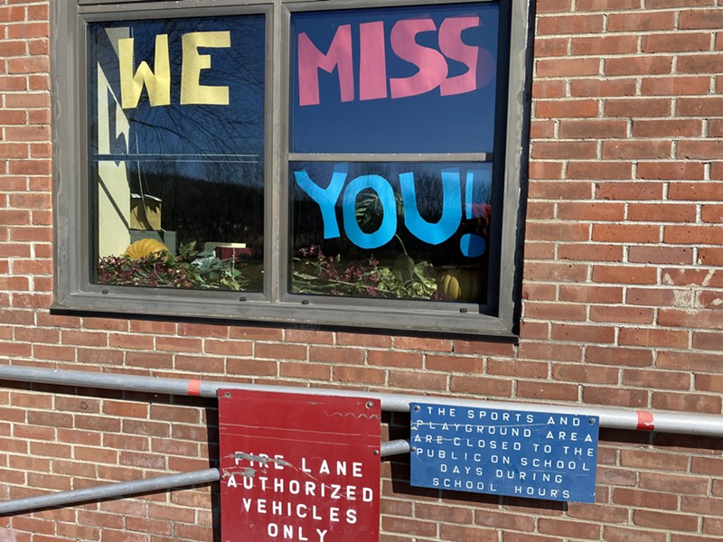 A sign in a window at the Hinesburg Community School - SASHA GOLDSTEIN
