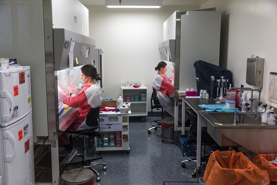 Workers running coronavirus tests at the Vermont Health Department lab - OLIVER PARINI
