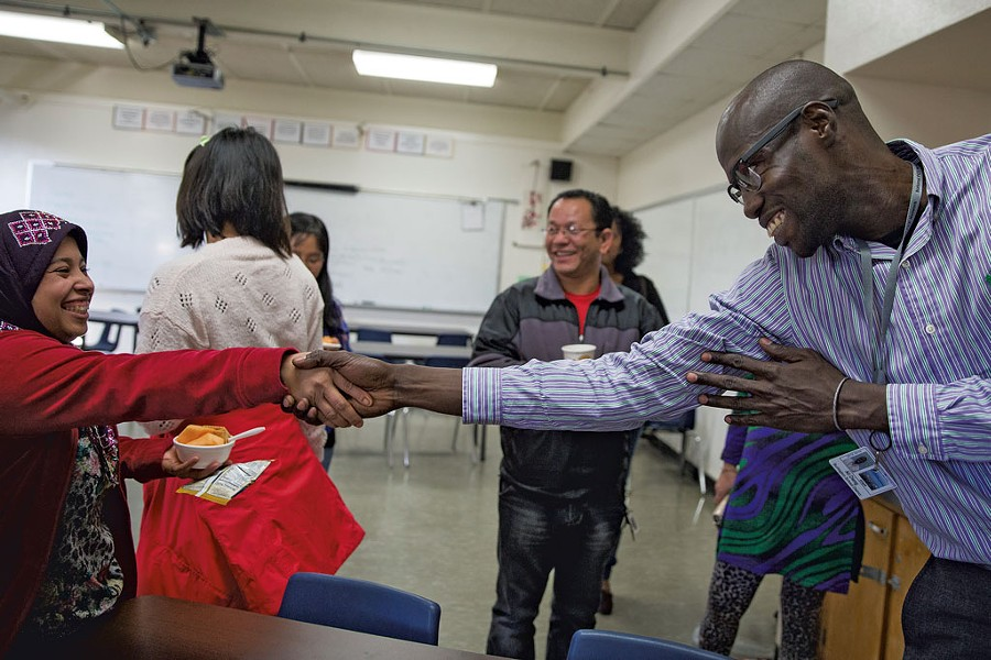 Ali Dieng, right, welcoming Khinaye Lwin, left, to Parent University - JAMES BUCK