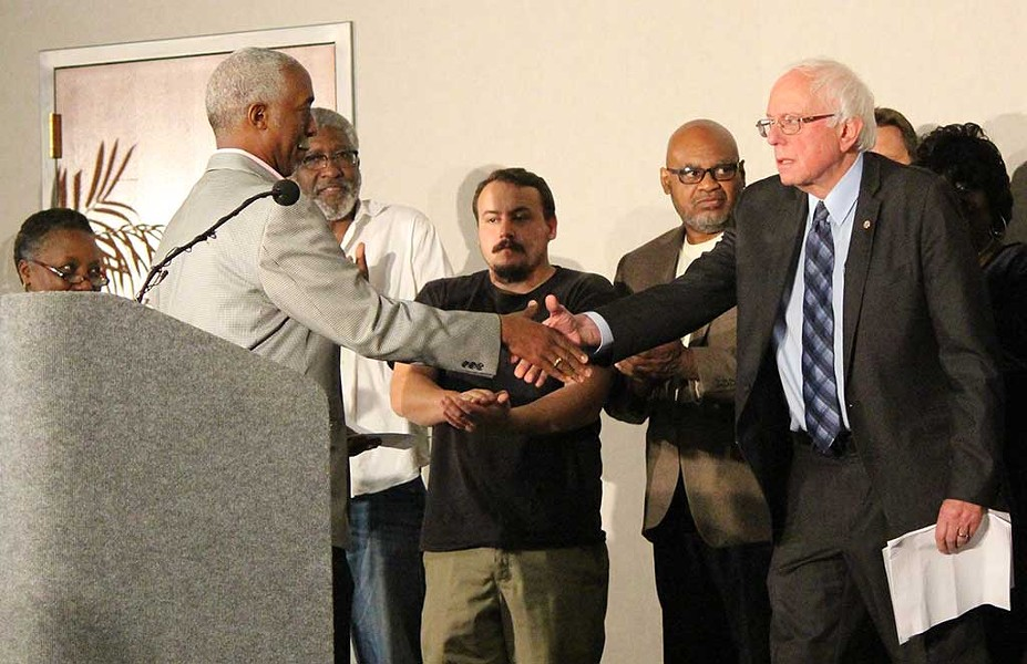 Rep. Terry Alexander shakes Sen. Bernie Sanders' hand at a press conference in Columbia, S.C. - PAUL HEINTZ