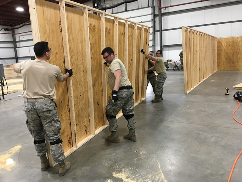 Vermont National Guard members erecting walls inside the exhibition hall - MATTHEW ROY