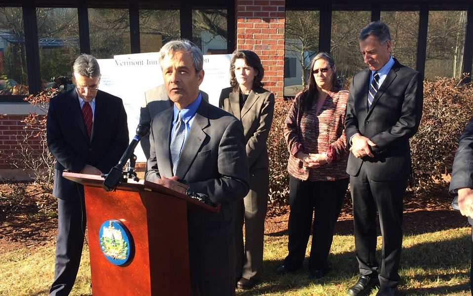 Robert Sand, Gov. Peter Shumlin's liaison to Criminal Justice Programs, speaks at a press conference outside the Chittenden Regional Correctional Facility in South Burlington, with Shumlin in the background.