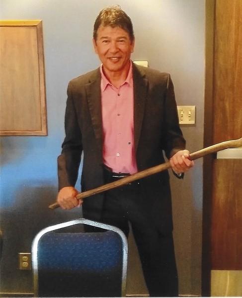Former Buffalo Sabres head coach Ted Nolan holding the Morse Stick in 2017 - COURTESY OF GARY MORSE