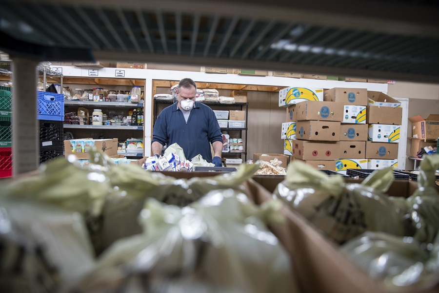 Packing food at Feeding Chittenden - JAMES BUCK