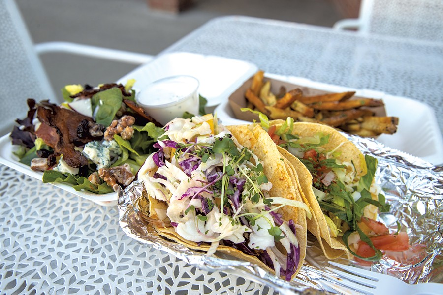 Waldorf salad, hand-cut French fries and tacos from the Drake Bar and Kitchen - JAMES BUCK
