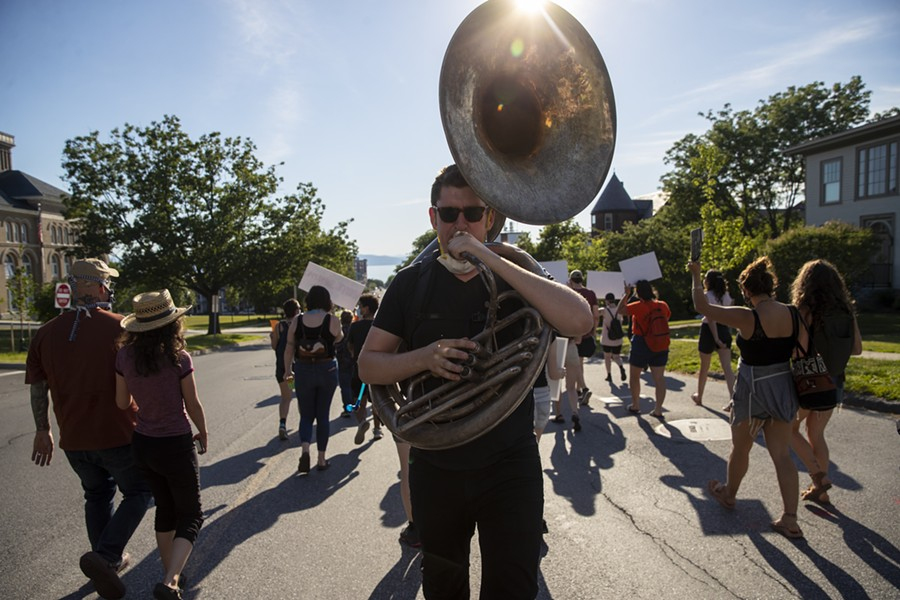 This protester played a sousaphone - JAMES BUCK