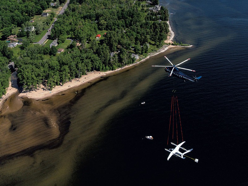 "Sikorsky S-61 helicopter delivering eVTOL ""Alia"" - ERIC ADAMS; COURTESY OF BETA TECHNOLOGIES"