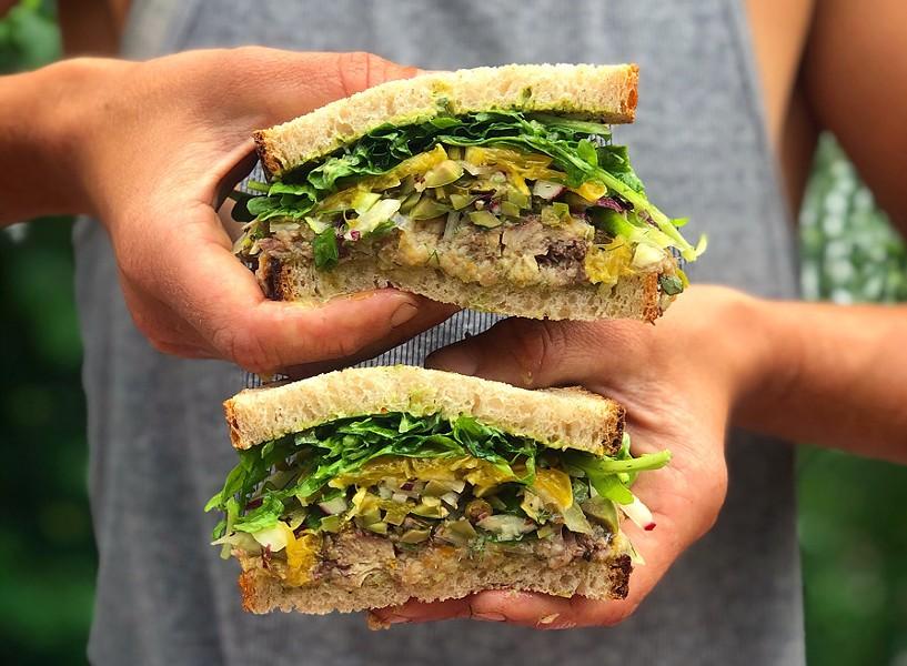 The Meryl sandwich from Poppy Café & Market: marinated sardines with herb aioli, fennel, radicchio, olives, capers, arugula and a citrus salad - COURTESY OF ABBY PORTMAN