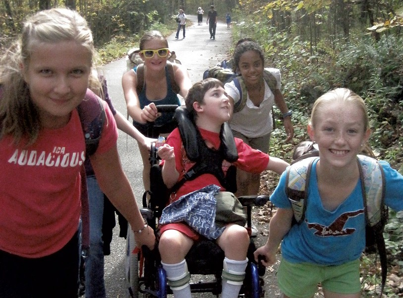Middle school classmates helping Ben Wood-Lewis climb Mount Philo back in 2011