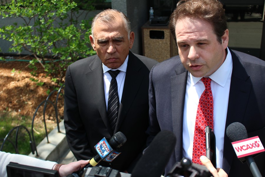 Ariel Quiros (left) with his former lawyer, Seth Levine, after a court hearing last year - PAUL HEINTZ ©️ SEVEN DAYS