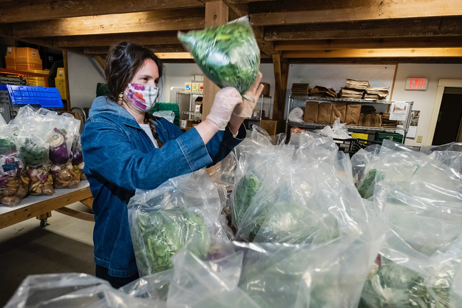 Andrea Solazzo, Vermont Foodbank agriculture and community outreach manager, packs produce for food shelf delivery - COURTESY OF VERMONT FOODBANK