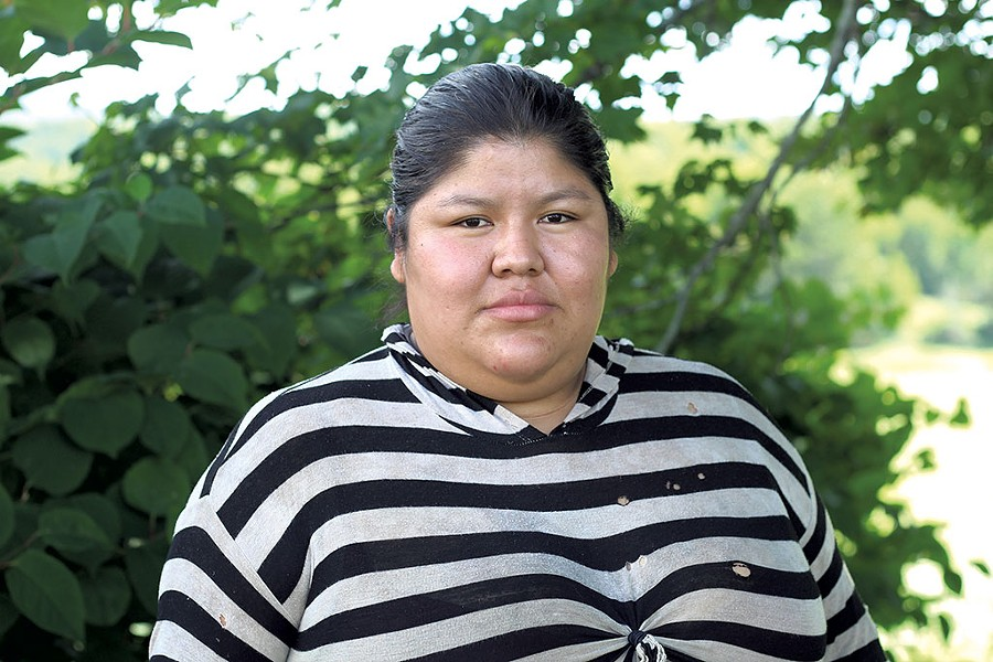 Pati, a migrant worker, on the northern Vermont farm on which she works - PAUL HEINTZ
