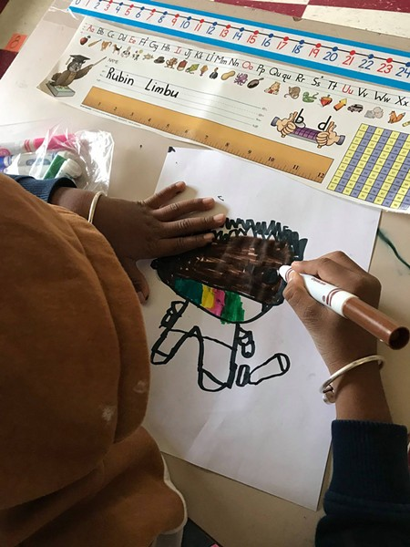 A student at JFK Elementary drawing a masked self-portrait - COURTESY OF THE WINOOSKI SCHOOL DISTRICT
