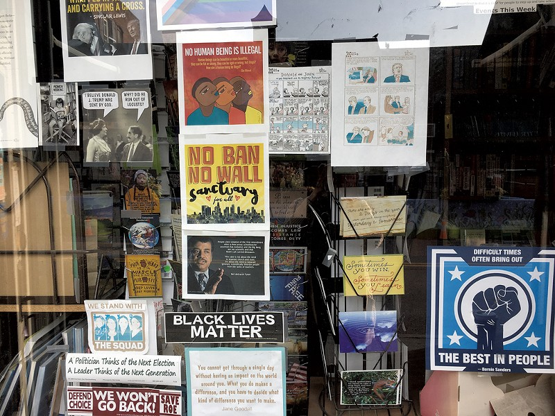 Political signs in a Brattleboro storefront - PAMELA POLSTON ©️ SEVEN DAYS